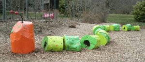 This whimsical wood caterpillar is sure to delight children and adults alike!