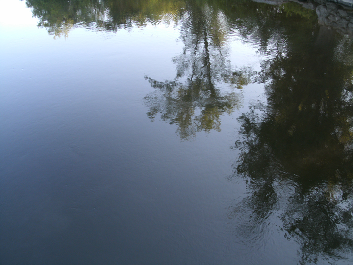 The Concord is an impressionist river, reflecting both trees and sky.