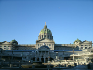 The peaceful side of the Harrisburg capitol building...with faint moon.